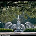 Fountain in Forsyth Park with couple standing. Savannah, Georgia, USA